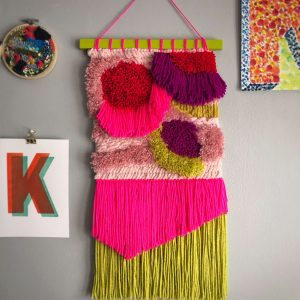 70s inspired latch hook tapestry with groovy bright colors