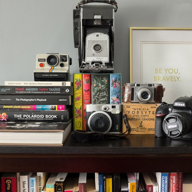 Mama + Maker Scholarship Fund Supports creative expression in many forms like photography with these vintage cameras among books